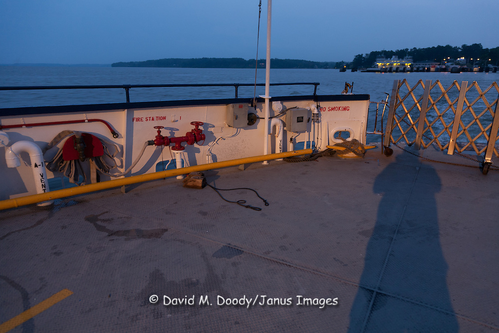 Photographer's Shadow. Scotland wharf in background on the Jamestown-Scotland Ferry across the James River at dusk, Virginia