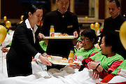SHANGHAI, CHINA - NOVEMBER 12: (CHINA OUT) <br /> <br /> Dining In Bed For New Guinness Record In Shanghai<br /> <br /> Waiters serve for the participants waiting for dining in bed at Pudong Shangri-la Hotel on November 12, 2014 in Shanghai, China. 338 participants take their breakfast in 202 beds during the activity of taking breakfast in bed which sets new Guinness record. The previous Guinness record was set by 288 members from Women's Health Initiative on March 12, 2013 in Australia. <br /> ©Exclusivepix