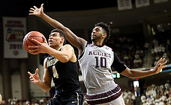 Vanderbilt's Wade Baldwin IV (4) goes up for a shot against Texas A&M's Tonny Trocha-Morelos  during the second half of an NCAA college basketball game, Saturday, March 5, 2016, in College Station, Texas. Texas A&M won 76-67. (AP Photo/Sam Craft)