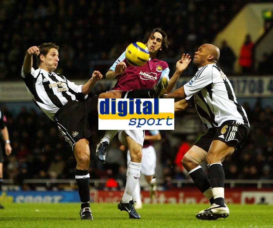 Photo: Chris Ratcliffe.<br />West Ham United v Newcastle United. The Barclays Premiership. 17/12/2005.<br />Yossi Benayoun (C) of West Ham is sandwiched by Robbie Elliott (L) and Alain Boumsong of Newcastle.