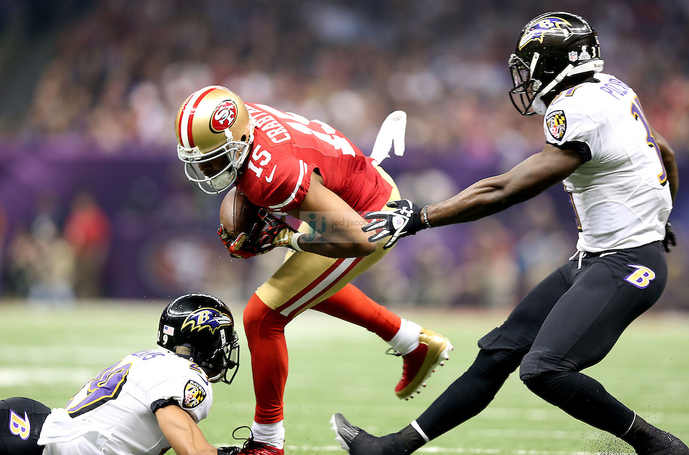 Michael Crabtree (15) of the San Francisco 49ers catches a pass against the Baltimore Ravens during the NFL Super Bowl XLVII football game in New Orleans on Feb. 3, 2013. The Ravens won the game, 34-31.  (Photo by Jed Jacobsohn)