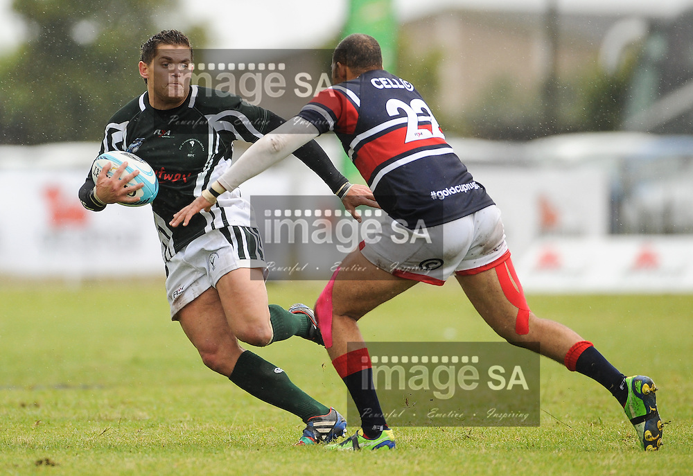 GEORGE, SOUTH AFRICA - Saturday 21 February 2015, Johannes Lambrechts of Pacaltsdorp Evergreens is chased by Nazeem van Sitters of One Logix United Bulk Villagers Worcester during the first round match of the Cell C Community Cup between Pacaltsdorp Evergreens and One Logix United Bulk Villagers Worcester at Pacaltsdorp Sports Grounds, George<br /> Photo by Roger Sedres/ImageSA/ SARU