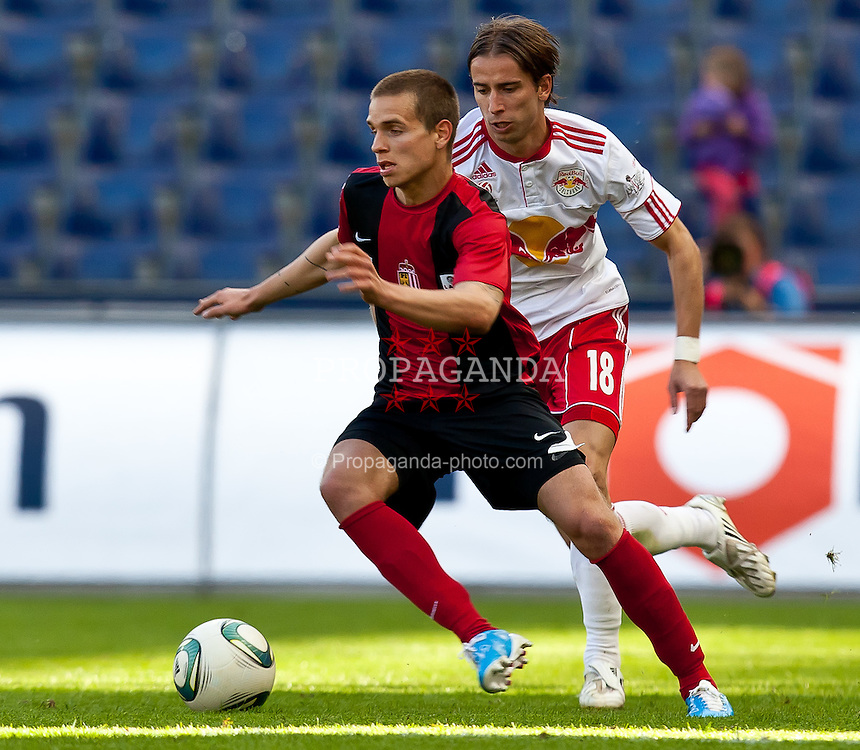09.04.2011, Red Bull Arena, Salzburg, AUT, 1. FBL, Red Bull Salzburg vs LASK Linz, im Bild Florian Hart, (LASK Linz, #12) vs Dusan Svento, (FC Red Bull Salzburg, Mittelfeld, #18) // during the Austrian Bundesliga Match, Red Bull Salzburg vs LASK Linz, at the Red Bull Arena, Salzburg, 09/04/2011, EXPA Pictures © 2011, PhotoCredit: EXPA/ J. Feichter