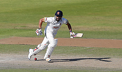 Essex's batsman Ravi Bopara makes runs from the bowling of Lancashire's Joe Mennie, on day three of the Specsavers County Championship, Division One match at Emirates Old Trafford, Manchester.