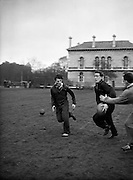 Butterfield, the English Captain and centre, bears a determined look as he attempts to break through, with Phillips in close attendance, during English team practice in College Park, Dublin, Friday 13th February, 1959,..Irish Rugby Football Union, Ireland v England, Five Nations, English team practice, College Park, Dublin, Ireland, Friday 13th February, 1959,.13.2.1959, 2.13.1959,..English Team, ..J G G Hetherington, Wearing number 1 English jersey, Full Back, Northhampton Rugby Football Club, Northhampton, England, ..P H Thompson, Wearing number 5 English jersey, Left Wing, Waterloo Rugby Football Club, Liverpool, England,..J Butterfield, Wearing number 4 English jersey, Captain of the English team, Left Centre, Northhampton Rugby Football Club, Northhampton, England, ..M S Phillips, Wearing number 3 English jersey, Right centre, Oxford University Rugby Football Club, Oxford, England,..P B Jackson, Wearing number 2 English jersey, Right Wing, Coventry Rugby Football Club, Coventry, England, ..A B W Risman, Wearing number 6 English jersey, Outside Half, Manchester University Rugby Football Club, Manchester, England,..S R Smith, Wearing number 7 English jersey, Scrum Half, Cambridge University Rugby Football Club, Cambridge, England,..L H Webb, Wearing number 8 English jersey, Forward, Bedford Rugby Football Club, Bedford, England,..J A S Wackett, Wearing number 9 English jersey, Forward, Rosslyn Park Rugby Football Club, London, England,..G J Bendon, Wearing number 10 English jersey, Forward, Wasps Rugby Football Club, London, England,..R W D Marques, Wearing number 11 English jersey, Forward, Harlequins Rugby Football Club, London, England,..J D Currie, Wearing number 12 English jersey, Forward, Harlequins Rugby Football Club, London, England,..A J Herbert, Wearing number 13 English jersey, Forward, Wasps Rugby Football Club, London, England,..A Ashcroft, Wearing number 14 English jersey, Forward, Waterloo Rugby Football Club, Liverpool, England,..J W Clements, We