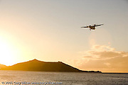 Airplane landing during sunset at the beach in Grand Case
