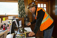 Safety Director Steve Stroschein looks at the log book inside the office at Pattison Sand Company in Garnavillo, Iowa on June 5, 2013.