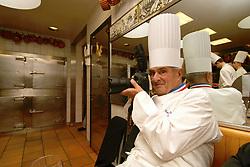 Collonges au Mont d'Or (69) : Paul Bocuse, le Pape de la gastronomie, s'improvise photographe dans les cuisines de son etablissement. 10/03/2006 High cuisine chef Paul Bose died at 91 it was announced on Saturday. Photo by Soudan/ANDBZ/ABACAPRESS.COM