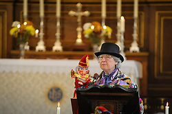 © Licensed to London News Pictures. 13/05/2018. LONDON, UK. A puppeteer gives a reading during the church service at the Covent Garden May Fayre at St Paul's Church, Bedford Street, known as the actors' church.  Now in its 43rd year, Punch and Judy professors and puppeteers celebrate the art of puppetry on Mr Punch's 356th birthday, near to where writer Samuel Pepys first saw Mr Punch in May 1662.  Photo credit: Stephen Chung/LNP