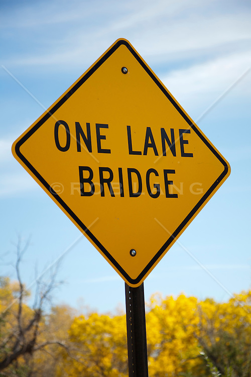 sign for a one lane bridge
