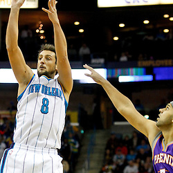 December 30, 2011; New Orleans, LA, USA; New Orleans Hornets shooting guard Marco Belinelli (8) shoots over Phoenix Suns small forward Jared Dudley (3) during the first quarter of a game at the New Orleans Arena.   Mandatory Credit: Derick E. Hingle-US PRESSWIRE