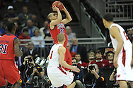 Ole Miss' Marshall Henderson (22) vs. Wisconsin in the NCAA Tournament at the Sprint Center in Kansas City, Mo. on Friday, March 22, 2013.