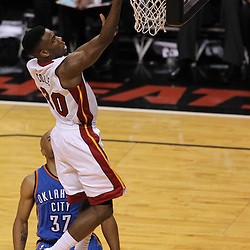 Jun 19, 2012; Miami, FL, USA; Miami Heat point guard Norris Cole (30) shoots against Oklahoma City Thunder point guard Derek Fisher (37) during the second quarter in game four in the 2012 NBA Finals at the American Airlines Arena. Mandatory Credit: Derick E. Hingle-US PRESSWIRE