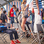 Timeout, All Too Much or Just Bored? Man takes sleeps whilst crowds use all vantage points to watch a Novak Djockovitch practice session, 2013 Australian Open Tennis, Melbourne, Victoria