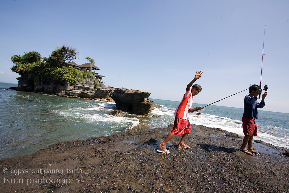 Boys fishing at Tanah Lot