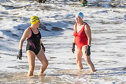 © Licensed to London News Pictures. 21/12/2019. Brighton, UK. Members of the Brighton Swimming Club go for a swim in the sea as rough waves are hitting the Brighton beach front. Photo credit: Hugo Michiels/LNP