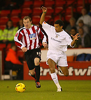 Photo: Aidan Ellis.<br /> Sheffield Utd v Luton Town. Coca Cola Championship.<br /> 01/11/2005.<br /> Sheffield's Alan Quinn battles with Luton's Carlos Edwards