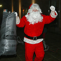 Edrington Group Childrens Christmas party  19.12.02<br />Santa arrives with the presents<br /><br />Pic by Graeme Hart<br />Copyright Perthshire Picture Agency<br />Tel: 01738 623350 / 07990 594431