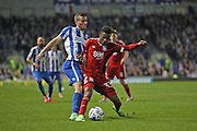 Birmingham City defender Cheick Keita (33) and Brighton & Hove Albion centre forward Tomer Hemed (10) during the EFL Sky Bet Championship match between Brighton and Hove Albion and Birmingham City at the American Express Community Stadium, Brighton and Hove, England on 4 April 2017.