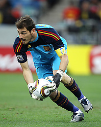 Spanish goalkeeper Iker CASILLAS collects the ball during the 2010 FIFA World Cup South Africa Group H match between Spain and Switzerland at Durban Stadium on June 16, 2010 in Durban, South Africa.