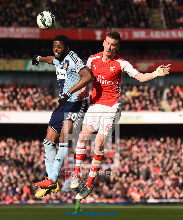 Laurent Koscielny of Arsenal and Alex Song of West Ham United during the Barclays Premier League match at the Emirates Stadium, London<br /> Picture by Andrew Timms/Focus Images Ltd +44 7917 236526<br /> 14/03/2015