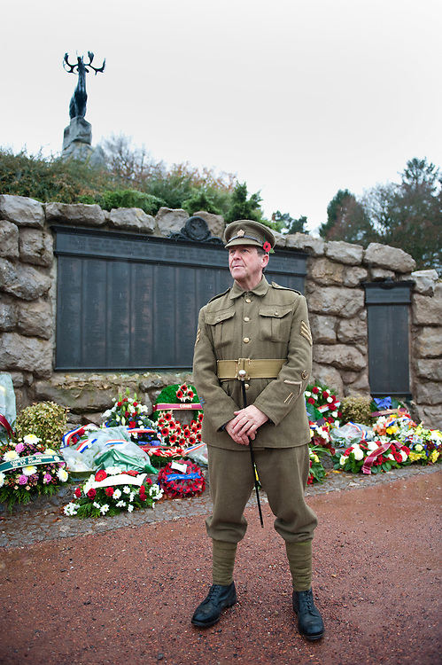 A man dressed with a Canadian Expeditionary Force  officers uniform poses in front of the Beaumont-Hamel Newfoundland Memorial that is dedicated to the commemoration of the Newfoundland Regiment that fought in the battle of Somme and WWI in general. Most of the  Newfoundland Regiment were dead within 15 to 20 minutes of leaving their trench in the morning of the 1st July 1916 during the first day of the Battle of the Somme.