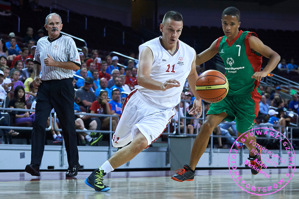 SO Poland athlete Dawid Rudewicz in action during basketball match between SO Poland and SO Portugal while basketball tournament during fifth day of the Special Olympics World Games Los Angeles 2015 on July 29, 2015 at Galen Centre University of Southern California in Los Angeles, USA.<br /> <br /> USA, Los Angeles, July 29, 2015<br /> <br /> Picture also available in RAW (NEF) or TIFF format on special request.<br /> <br /> For editorial use only. Any commercial or promotional use requires permission.<br /> <br /> Adam Nurkiewicz declares that he has no rights to the image of people at the photographs of his authorship.<br /> <br /> Mandatory credit:<br /> Photo by &copy; Adam Nurkiewicz / Mediasport