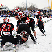 Alexander LaPolice, New Canaan, is congratulated by team mates after scoring a touchdown during the New Canaan Rams Vs Darien Blue Wave, CIAC Football Championship Class L Final at Boyle Stadium, Stamford. The New Canaan Rams won the match in snowy conditions 44-12. Stamford,  Connecticut, USA. 14th December 2013. Photo Tim Clayton
