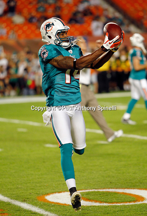 Miami Dolphins wide receiver Marlon Moore (14) catches a pregame pass during the NFL week 11 football game against the Chicago Bears on Thursday, November 18, 2010 in Miami Gardens, Florida. The Bears won the game 16-0. (©Paul Anthony Spinelli)