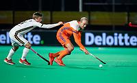 ROTTERDAM - Billy Bakker (NED) is hold by  Mats Grambusch (Ger) during  the Pro League hockeymatch men, Netherlands- Germany (0-1). )  WSP COPYRIGHT  KOEN SUYK