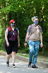 © Licensed to London News Pictures. 08/05/2020. London, UK. Members of the public wearing face coverings arrive in Alexandra Palace in North London on a warm and sunny bank holiday. Prime Minister Boris Johnson is set to announce on Sunday, 10 May, measures to easy coronavirus lockdown, which was introduced on 23 March to slow the spread of the COVID-19. Photo credit: Dinendra Haria/LNP