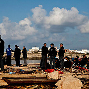 North African immigrants are helped by italian police while approaching by an Illegal boat .the Island of Lampedusa. Despite the efforts of italian government who evacuated more 600 northen african refugees yesterday by the S. Marco ship, boats continues to attrack in the Island making the situation worser worser. The portual area of Lampedusa has become a second open air immigration centre where immigrants living  in critical igenic and sanitary conditions..