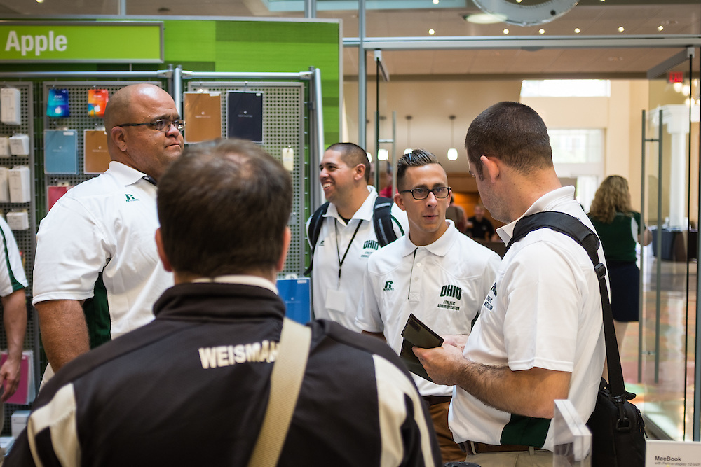 Master's in Athletic Administration students visit with one another in the Bobcat Depot while waiting for their new student ID's during a walking tour of campus on Friday, June 26, 2015. © Ohio University / Photo by Rob Hardin
