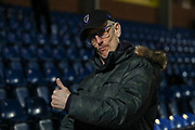 AFC Wimbledon fan giving thumbs up during the EFL Sky Bet League 1 match between AFC Wimbledon and Burton Albion at the Cherry Red Records Stadium, Kingston, England on 28 January 2020.