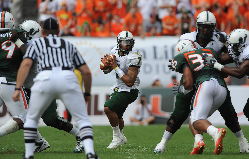 MIAMI GARDENS, FL - NOVEMBER 27: B.J. Daniels of the South Florida Bulls drops back to pass during the game against the Miami Hurricanes at Sun Life Stadium on November 27, 2010 in Miami Gardens, Florida.
