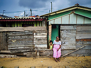 07 OCTOBER 2017 - MORATUWA, SRI LANKA: A woman sits in front of her home in Moratuwa, a fishing village south of Colombo. Fish is an important source for many Sri Lankans.  PHOTO BY JACK KURTZ