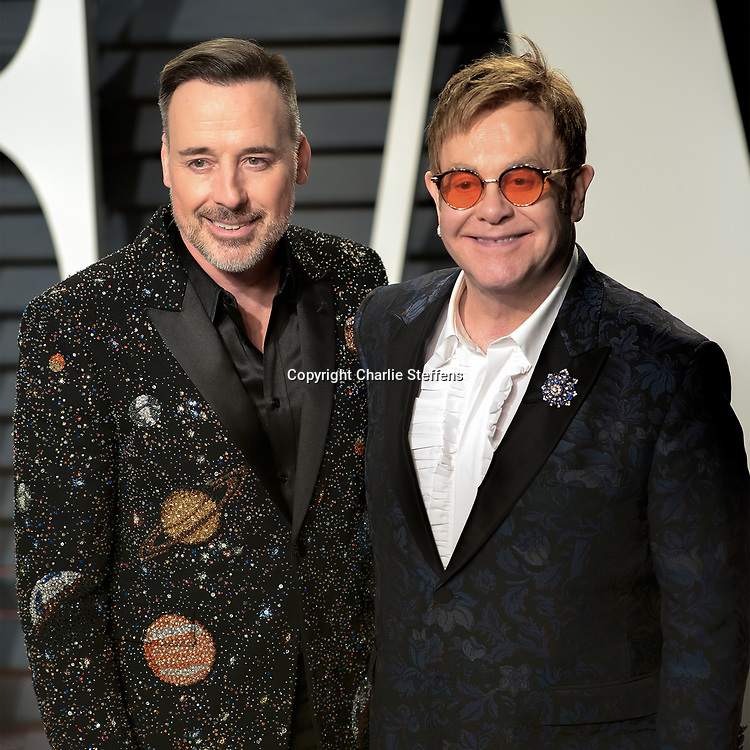 David Furnish and Elton John at the Vanity Fair Oscar Party on February 26, 2017 at the Wallis Annenberg Center for the Performing Arts in Beverly Hills, California (Photo: Charlie Steffens/Gnarlyfotos)