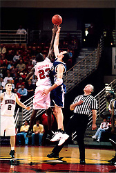 November 16, 2001:  Illinois State Redbird basketball player Baboucarr Bojang completes the tip off..This image was scanned from a print.  Image quality may vary.  Dust and other unwanted artifacts may exist.