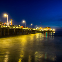 Santa Monica CA Pier at night in blue and gold. Copyright ⓒ 2017 Paul Velgos with All Rights Reserved.