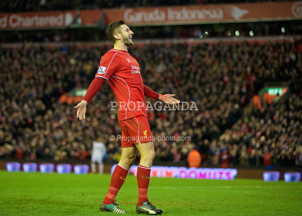 LIVERPOOL, ENGLAND - Monday, December 29, 2014: Liverpool's Adam Lallana celebrates scoring the second goal against Swansea City during the Premier League match at Anfield. (Pic by David Rawcliffe/Propaganda)