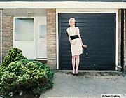Mika, a teenage transvestite, stood outside her house, Southend, UK 2006