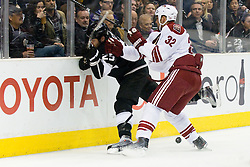 Dustin Penner (Los Angeles Kings, #25) vs Michal Rozsival (Phoenix Coyotes, #32) during ice-hockey match between Los Angeles Kings and Phoenix Coyotes in NHL league, March 3, 2011 at Staples Center, Los Angeles, USA. (Photo By Matic Klansek Velej / Sportida.com)