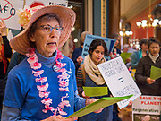 "23 JANUARY 2020 - DES MOINES, IOWA: MARY ANN KOCH, from Urbandale, a suburb of Des Moines, a member of the ""Raging Grannies,"" sings about the dangers of factory farms during a rally in the Iowa State Capitol against factory farms. About 75 people, including farmers, environmental activists, and supporters of family farms, came to a protest in the rotunda of the state capitol in Des Moines. They are trying to pressure Iowa lawmakers to pass a moratorium against new factory farm construction in Iowa.       PHOTO BY JACK KURTZ"