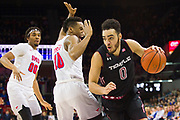 DALLAS, TX - JANUARY 04:  Obi Enechionyia #0 of the Temple Owls brings the ball up court against Jarrey Foster #10 and Ben Moore #00 of the SMU Mustangs during a basketball game on January 4, 2017 at Moody Coliseum in Dallas, Texas.  (Photo by Cooper Neill/Getty Images) *** Local Caption *** Obi Enechionyia; Jarrey Foster; Ben Moore
