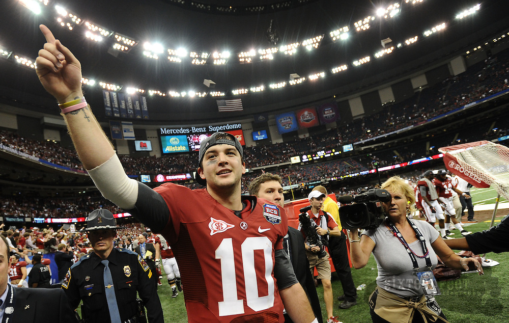 Daily Photo by Gary Cosby Jr.    ..AJ McCarron, offensive MVP, celebrates as he leaves the field after Alabama defeated LSU 21-0 to claim their 14th National Championship...................................