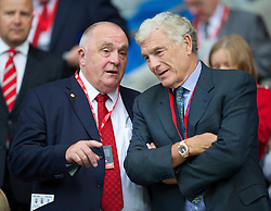 CARDIFF, WALES - Tuesday, August 21, 2014: Wales' FAW President Trefor Lloyd-Hughes and England's Trevor Brooking before the FIFA Women's World Cup Canada 2015 Qualifying Group 6 match at the Cardiff City Stadium. (Pic by David Rawcliffe/Propaganda)