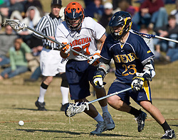 Drexel Dragson A Scott Perri (23) and Virginia Cavaliers D Ken Clausen (27) go after a loose ball.  The #2 ranked Virginia Cavaliers defeated the Drexel Dragons 13-7 at the University of Virginia's Klockner Stadium in Charlottesville, VA on February 14, 2009.