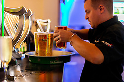 A member of Sandy Park bar staff prepares Pints of Heineken at the Bar - Ryan Hiscott/JMP - 06/08/2018 - RUGBY - Sandy Park - Exeter, England - Exeter Chiefs Season Launch Dinner