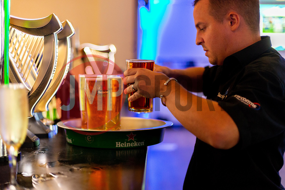 A member of Sandy Park bar staff prepares Pints of Heineken at the Bar - Ryan Hiscott/JMP - 06/08/2018 - RUGBY - Sandy Park - Exeter, England - Exeter Chiefs Season Launch Dinner