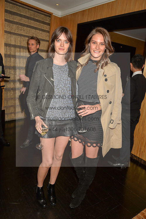Left to right, SAM ROLLINSON and CHARLOTTE WIGGINS at the Louis Vuitton for Unicef Event #MAKEAPROMISE held at The Apartment, 17-20 New Bond Street, London on 14th January 2016.